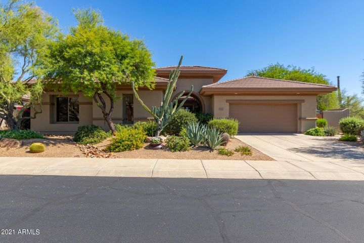 Privacy abounds with no neighbors on one side and your own private natural desert backyard with views of Lone Mountain.