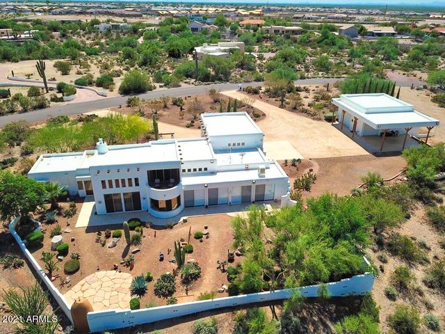 """Gorgeous Santa Fe style Villa with a Detached workshop & garage with 2- 14"""" roll up garage doors and covered parking with a loading dock on 3.4+ acres."""