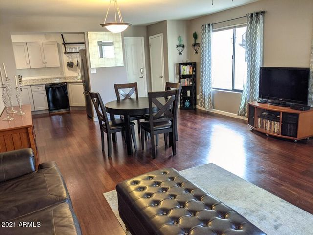 Large living/dining area with large windows