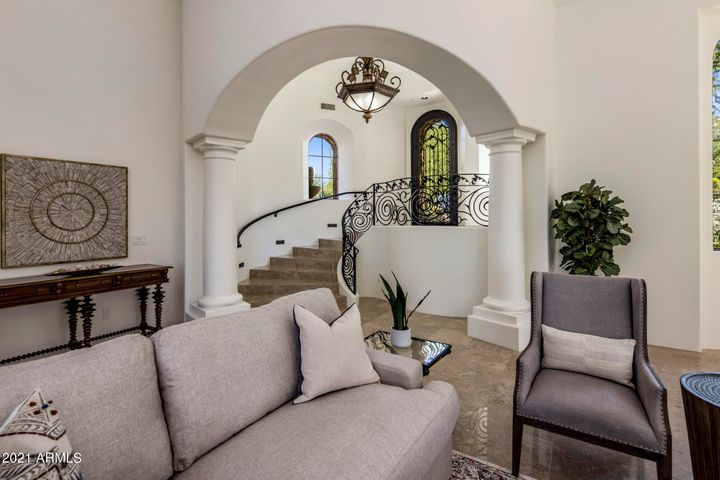 Enter and take in the beauty of the Grand Room. This stunning space, with its high ceilings, beautifully designed windows, and French doors leading out to the private courtyard, captures the meaning of elegance.