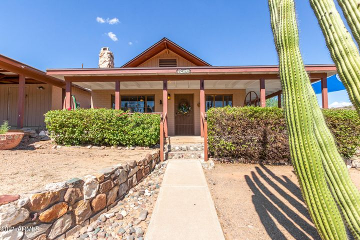 Hiking trail access is seconds away. Huge lot! extended driveway covered gazebo area out back. excellent Mountain View's basketball court you can see all the way to downtown from the upper lot and front porch. There is building potential for the upper lot! Amazing mountain views