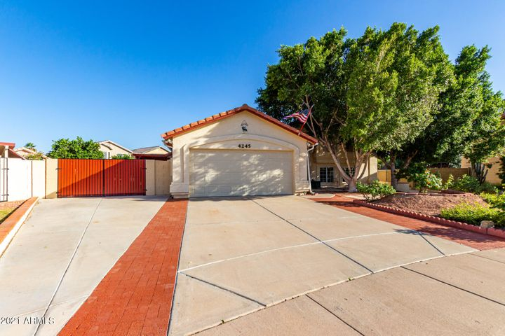 3 car concrete driveway parking and inlaid brick frames the driveway with 12' RV gate!