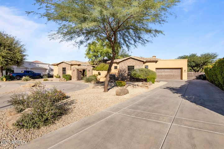 Welcome to this private estate on over 1/2 acre with awesome curb appeal