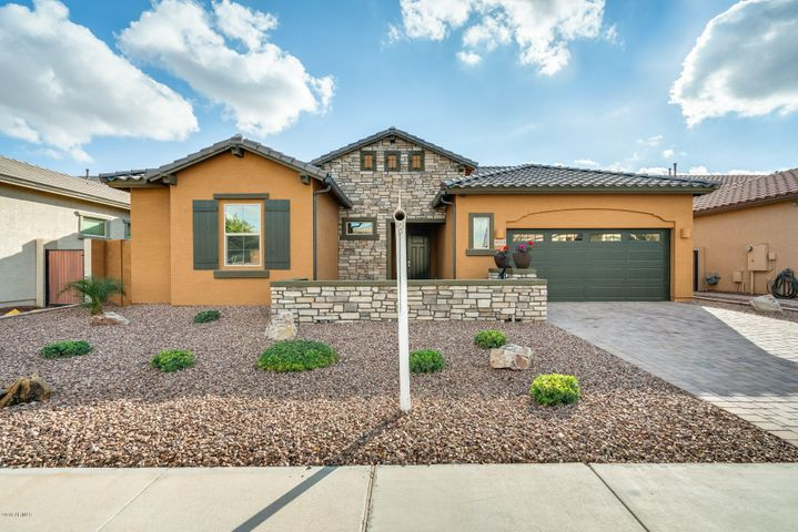 Step into your beautiful home located in Queen Creek. 4 bed, 2 bath with great features throughout. The front courtyard is perfect for sitting back to enjoy the great weather. There is stunning tile in all the right places. Your kitchen will be centered around entertaining friends and family! The spacious island is perfect for entertaining easily with your guests and the extended sliding glass door adds an abundant amount of natural light. Inside your master suite, you have double sinks, a large walk-in closet, and a tub or shower - take your pick! Do not wait. Schedule your showing today!