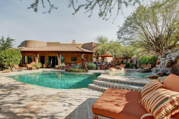 Luxury 5-Acre Estate 35-mins from Sky Harbor. This property has everything you need for fun & easy living. Fully fenced property w/open parking for all your cars, trucks, toys & trailers. 95x240 fenced & watered arena, shaded pens w/space to roam, & swamp cooled Premiere Sips Barn (super insltn/constrctn). Barn Guest Qtrs offers full bath w/d & Great Bonus Income Potential! Horses are comfortable year-round in oversized stalls w/water, fans, & walk-outs.  Tack Rm w/kitchenette, saddle racks, & extra deep cabinets. Home boasts wood/travertine/tile throughout. Open living w/high end finishes, custom cabinets, gorgeous wood beams atop high ceilings & more! Don't miss the state of the art Theater Room, Steam Shower, workout/mud room, Lighted Sports Court, Luxury Pool/Spa, BBQ