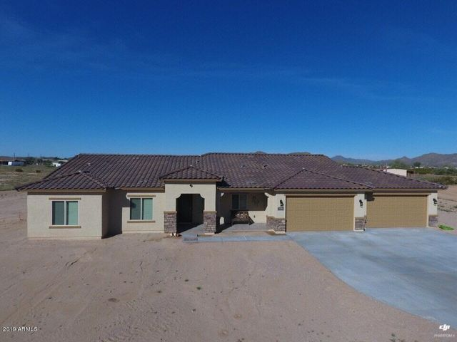 If you are looking for a GOREGOUS home on 1.28 acres of land with Mountain Views and NO HOA, LOOK NO FURTHER. This 3 bedroom plus a large office and 2 bath home has tile flooring throughout. The kitchen has additional cabinets to make the kitchen huge. The large kitchen island looks out into the great room. All cabinets throughout the home have soft close, which adds that custom feel to this home. The Master Bedroom is tucked in a way which is separate from the rest of the bedrooms and has that private feel. The 4 car garage has an additional garage door that faces the back of the home. The seller added additional concrete to the back patio and also the driveway to ensure plenty of parking spaces. There are so many other great qualities about the home, it's best to come see for yourself.