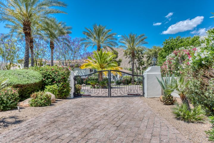 Tucked away on a private cul-de-sac lot in the heart of Arcadia sits this stunning Santa Barbara estate. From the moment you enter the iron gates you are greeted by a breathtaking environment of lush grounds that give way to Camelback Mountain views. This one-of-a-kind estate boasts quality finishes throughout and large living spaces that include a game room, workout room, and multiple en-suite bedrooms. The incredible master retreat is designed with his/hers bathrooms and closets, as well as a separate living room with spectacular views. The guest bedrooms upstairs all have Camelback views with private balconies. In the backyard you will enjoy the grand patios, sparkling pool, sport court, and batting cage. Call today to schedule an appointment!