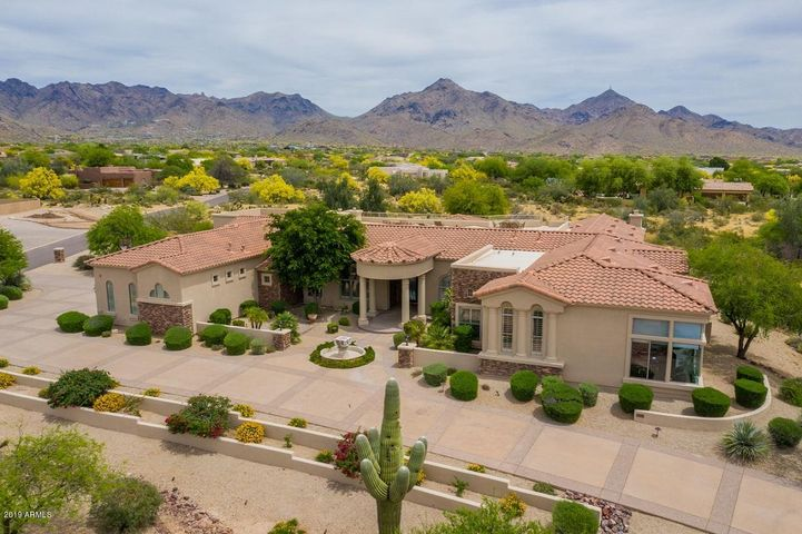 You have to see these outstanding views!  Too amazing to describe!  Beautiful custom home on 1.7 acres. Luxury amenities from top to bottom.  Cozy and Family friendly design. Dramatic Glass wall of windows at Entry overlooking Resort backyard and panoramic view of the McDowell Mtns. 3 Gas Fireplaces, Lit coffered ceilings & Canterra wrought iron exterior doors.  Chef's Kitchen w/oversized island. Luxurious Master Suite and 3 additional ensuite bedrooms plus den.  Spacious Gym with Sauna and Steam Rm.  Large game room with bar area.  Resort backyard features Spacious salt water pool with water features, 8 person spa, outdoor gazebo kitchen, putting green & firepit.  Enjoy the convenience of Pima Acres!  Close to freeway & Scottsdale dining, restaurants and amenities,