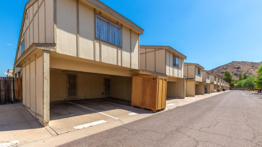 A great opportunity to own a recently renovated townhome in the heart of North Phoenix. This darling home in a gated community with mountain views is close to schools, parks, shopping & freeways. The first floor has a great room that adjoins a patio area for outdoor living, with an eat in kitchen and inside laundry and a half bath. Upstairs you have a full bath and 2 bedrooms with lots of closet space. New flooring throughout - Fresh custom 3 tone paint - A/C just serviced - New sliding door to Side Patio - New water heater - New electric panel - New toilets - New living room window - New bath tub - New tiled shower - Added roof to the outside storage. All renovations professionally & tastefully done! NO ONE ABOVE OR BELOW YOU! Don't miss this one!