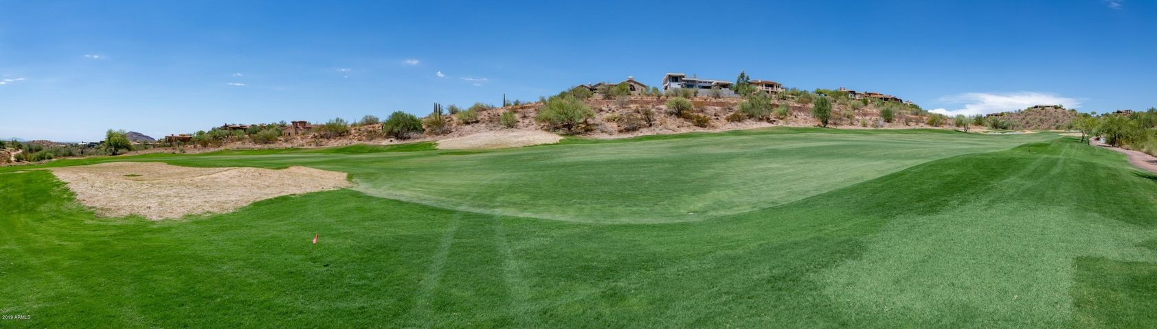 Prime golf course lot in the prestigious, gated Firerock community!  This R-18 zoned lot is just over half an acre and backs up to the golf course, offering fantastic views of the green, mountains, and city lights.  Build your dream home on an ideal lot in a beautifully maintained community.
