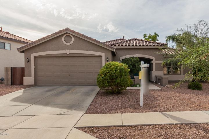 Fabulous single level home in North Phoenix w/ an open concept floorplan, 3 bedrooms + den/office, OWNED SOLAR, 2 car garage with built-in shelves, RV gate with large side yard, and professionally landscaped backyard with artificial grass and brick pavers. The updated kitchen opens to the spacious living room and features granite countertops, an island w/ breakfast bar, stainless steel appliances, tile backsplash, and extra cabinets for additional storage. The roomy master bedroom has a large walk-in closet w/ closet system, double sink vanity with granite counters, and walk-in shower. Extra storage throughout including in laundry room and garage. Cozy backyard with a covered patio is perfect for kids or pets. Conveniently located near the I-17 freeway for an easy commute, and minutes from the shops at Norterra, grocery stores, restaurants, and more.