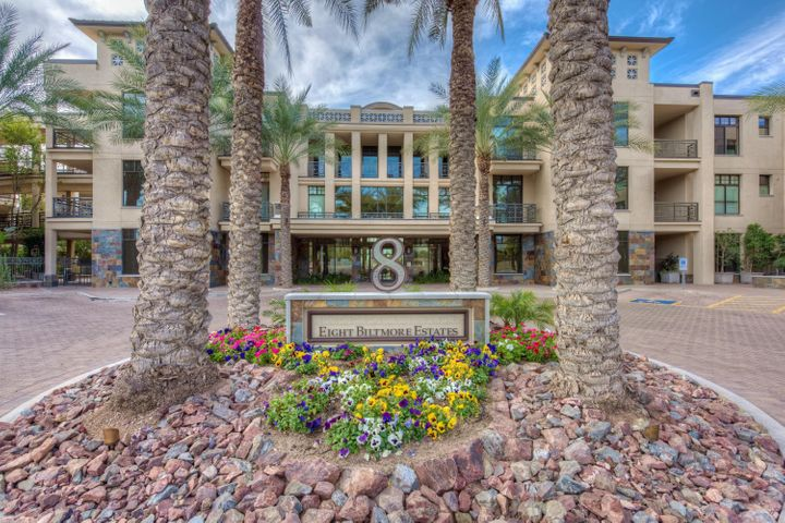 Welcome to this stunning home in Fairway Lodge and embrace the chance to experience the very best in luxurious living with top-tier amenities in a prime location. Situated right on the Adobe golf course, this garden-level unit offers fantastic views of the perfectly manicured links and the Downtown Phoenix skyline. With close proximity to the resort-style community pool, fitness center, and clubhouse, this location within the community cannot be beat! The open concept of this N/S facing home is perfect for entertaining guests and the spacious, covered patios off of the dining room and master bedroom offer a chance to soak up the fantastic Arizona sunshine.