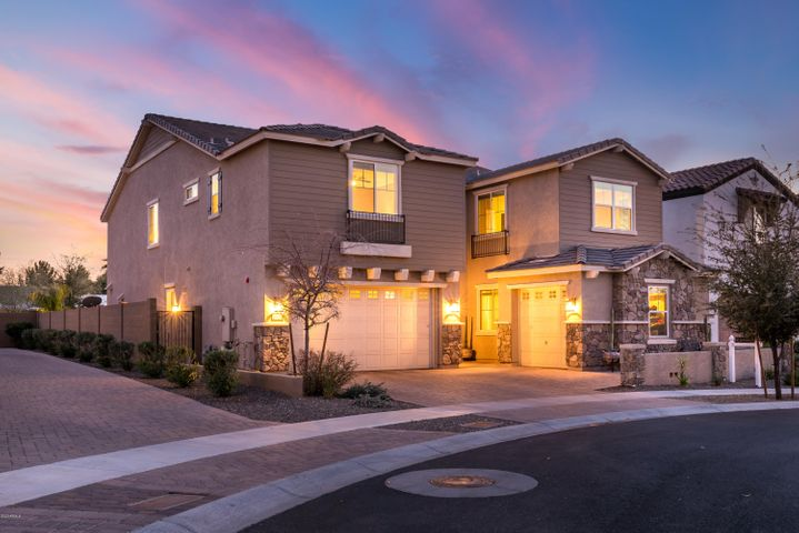 Built in 2015, this immaculate home is nestled between the Biltmore and Arcadia Lite, in the gated community of Madison Vistas. This modern, two-story dream boasts quality finishes at every turn and the open concept is perfect for entertaining guests. The gourmet kitchen features beautiful top-tier appliances, custom cabinetry, and a stunning center island with breakfast bar. On the second floor, you'll find a spacious den and a master retreat fit for royalty. The backyard oasis is accessed through a retractable patio wall in the living room and offers a sparkling pool, low-maintenance turf, and a spacious covered patio for al fresco dining. With a 4-car garage to safely store your cars and fun toys, this home has it all!