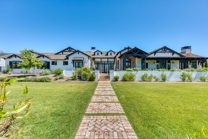 Constructed by the acclaimed builders at Rafterhouse in 2016, this awe-inspiring Arcadia estate offers enduring beauty and quality craftsmanship on the highly sought-after Arcadia street known as Lafayette Boulevard. In addition to striking views of Camelback Mountain, this estate features 5 bedrooms, an office, and 6 bathrooms. Every inch of the home is beautifully designed with contemporary finishes that exude a timeless allure. The endless list of superior finishes includes lofty wood-beamed ceilings, clerestory windows, wood plank flooring, crown molding, marble tile and countertops, french doors and windows, and so much more. The gourmet kitchen is an epicurean dream, featuring a Wolf gas range, SubZero refrigerator, custom Burdette cabinetry, walk-in pantry, and wet bar.