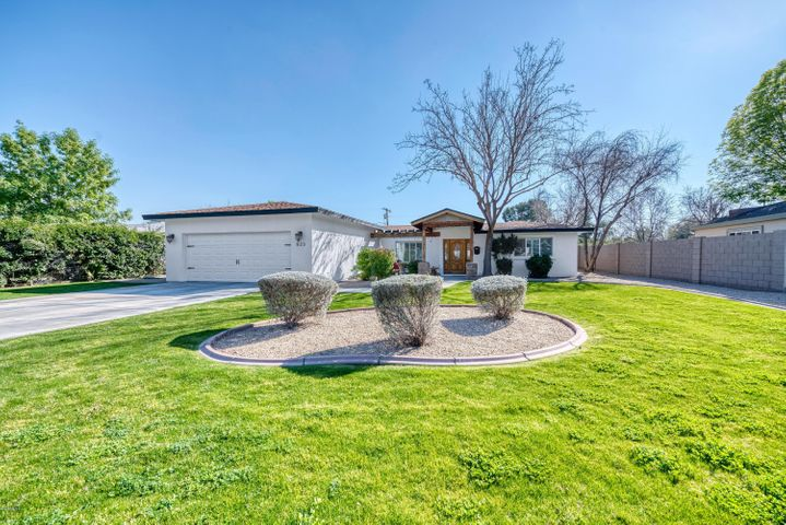 This updated North Central ranch home is a must see! Sitting on a 17,000+ N/S facing lot in Sun View Estates, this traditional contemporary home features 4 bedrooms and 3 bathrooms in the main house and 1 bedroom with a full bathroom in the backyard guest casita. This one checks all the boxes with its open concept, upgraded finishes, split floor plan, prime location, expansive lot, NO HOA, and opportunity for extra income with the detached casita. Schedule your showing today, before it's gone!