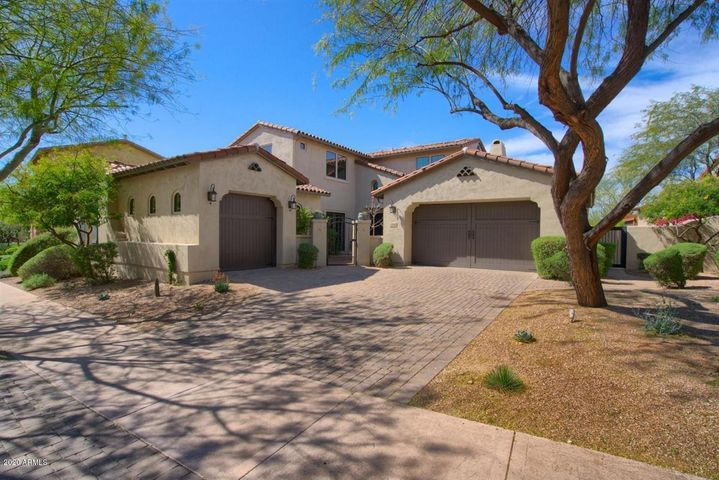 Beautiful updated home located in the gated community of Desert Haciendas in DC Ranch. This turn-key residence features 5 bedrooms, 2 large bonus rooms, and a resort backyard that offers gorgeous sunset views! The kitchen has been nicely updated with white cabinetry, a contrasting center island with farm sink & breakfast bar and opens to the family room, which offers a 2-way stone fireplace and an exit to the covered patio. The master bedroom, 2 secondary bedrooms and a bonus room are all located on the main floor. Upstairs you will find a huge loft with surround sound and 2 additional secondary bedrooms. The oversized backyard is a desert paradise with lush landscaping, a sparkling pool, spa, multiple bubbling water features, a spacious Ramada with fireplace and a built-in BBQ.