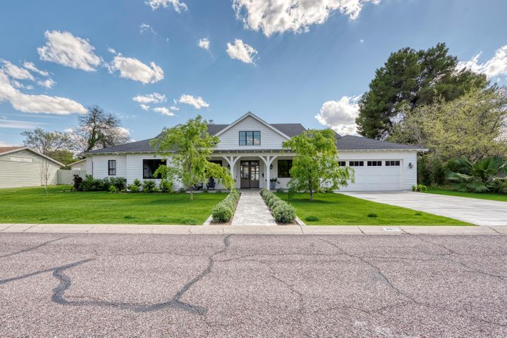 This idyllic Arcadia home has it all - a highly desirable location, contemporary farmhouse design, top-tier finishes, a spacious lot, and no HOA fees. Built in 2018, this stunning property features a split floor plan, private bathrooms in all four of the bedrooms, a large office with beautiful shelving, and a cozy den for family movie nights. Soaring, vaulted ceilings bring this beautiful home home to life and light wood floors tie the interior space together. The gourmet kitchen features a quartz center island, SubZero & Wolf appliances, farmhouse sink, and an adorable breakfast nook with peaceful backyard views. Come and see this turn-key gem for yourself!