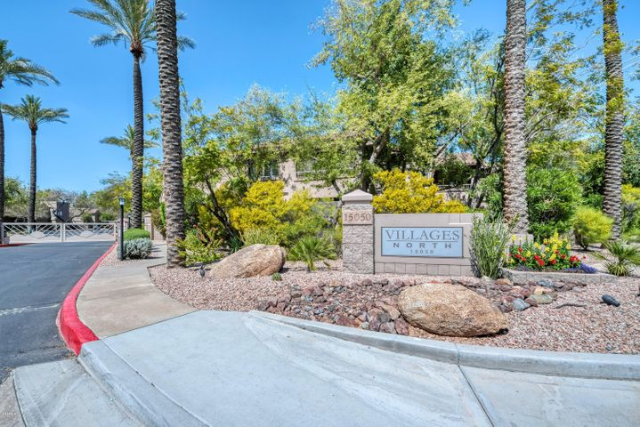 Welcome to this charming two-bedroom condo in the gated, well-maintained community of Villages North! Conveniently located near the Loop 101 Freeway, WestWorld of Scottsdale (home of the Barrett-Jackson car auction), and TPC Scottsdale, this complex is also situated across the street from AJ's Fine Foods, Safeway, Walgreen's, and a handful of delicious local restaurants. With four heated pools, peaceful greenbelts, tennis courts, and fountains, this beautiful community is sure to please. Inside the home, you'll find an open floor plan with vaulted ceilings, new carpet, and plenty of natural light. The eat-in kitchen features new stainless steel appliances and the spacious master suite offers access to the patio with pool views and private storage unit. Your assigned, covered parking space is right in front of the unit and one of the sparkling pools is just around the corner. Come see it before it's gone!