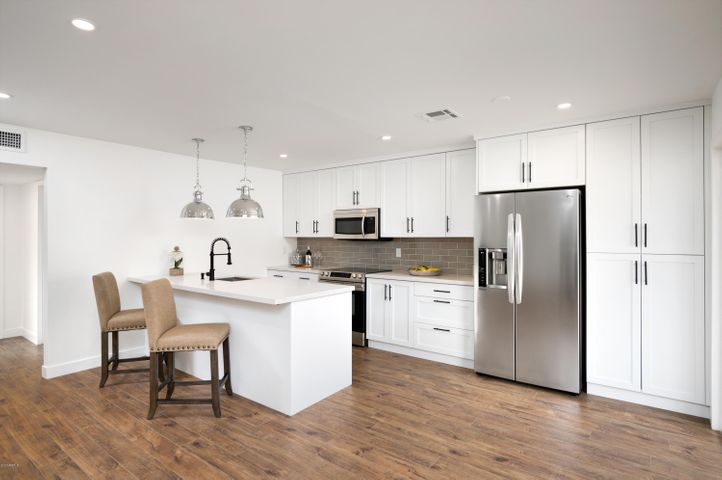 This pristine condo has been completely remodeled with nothing left undone! The open floor plan features a custom kitchen with brand new stainless steel appliances, soft-close cabinetry, and beautiful quartz countertops. All new doors, dual pane windows, recessed lighting. and flooring throughout. The gorgeous renovated bathroom has a custom walk-in shower and all new tile, fixtures and cabinets. The master bedroom features a spacious walk-in closet. Townhome is located upstairs with No One Below and has a private storage closet underneath. PRIME location near Old Town Scottsdale, shopping, dining, airport and ASU. VIRTUAL SHOWING AVAILABLE - upon request.