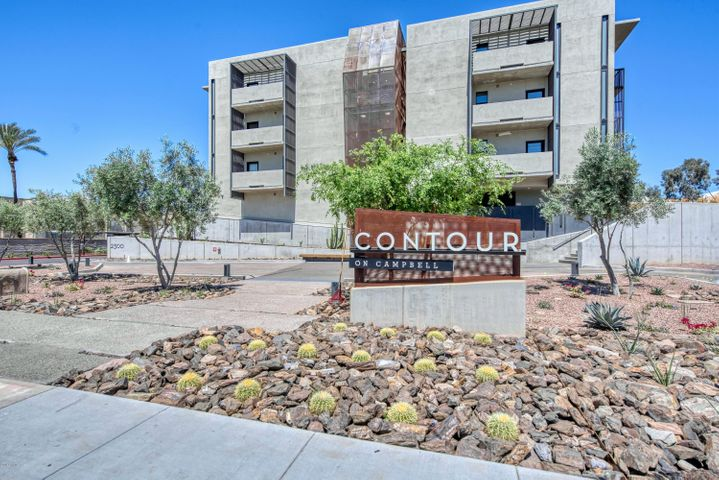 This turn-key. luxury condo is located in one of the most desirable locations in the greater Phoenix area! CONTOUR on Campbell offers high-end amenities, including a fitness facility and resort-style pool, and sits just around the corner from Town & Country Shopping Center, Camelback Colonnade, and Biltmore Fashion Park. This particular unit features an open floor plan with two master suites and a spacious den/office. Top-tier finishes include hardwood floors, quartz counters, custom cabinetry, and Bosch/LG appliances.