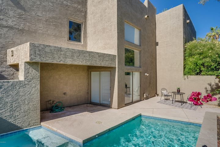 Not only is this an excellent location, but it comes with your own private splash POOL! This 2 bedroom, 2 bath townhome is located at McDonald and Scottsdale Rd, within the boutique, gated community of Las Villas. This spacious floor plan of over 1600 SF has a maintenance-free spacious back patio, a private patio off the master for sunset viewing and an attached 2 car GARAGE! The HOA is super healthy with a really low monthly assessment of HOA of $270. Community amenities include a gated entrance, pool, spa and direct access to walking pats along the canal and greenbelts. Live in the Heart of Scottsdale within walking distance to Scottsdale amenities for dining, shopping and recreational activities.
