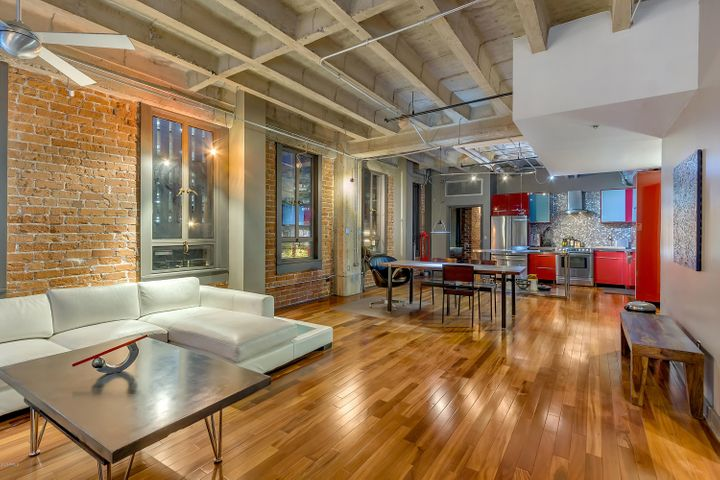 This is the best 2 bedroom condo located within Orpheum Lofts! This spacious split floor plan in 1706 SF is a corner residences with eastern exposure. The building is constructed with concrete and brick, offering excellent sound abatement. The residence consists of 10' 8'' ceilings, Brazilian Koa wood floors, warm red brick exterior walls and exposed duct-work in an open floor plan. Located in a premium location within the community on the 2nd floor with direct access to the courtyard with grills and outdoor seating - great spot for morning coffee and easy access to grills for dinner. Feel the energy downtown through the wall of windows offering great city night light views. In addition to the abundance of storage within the residence, large secured storage locker in basement. Built in 1931, formerly the Phoenix Title & Trust building, the building was recreated in Art Deco-styled residences. Amenities include secured entrance, elevators to all floors, heated pool with wave machine, fitness center, steam room, sauna, resident recreation room, conference/meeting room, outdoor courtyard with grills and seating. Lobby attendant onsite 7am-2am daily. The location downtown is very walkable to dining, entertainment, theaters, movies. And, of course Roosevelt Row! Super healthy HOA includes Internet and water.