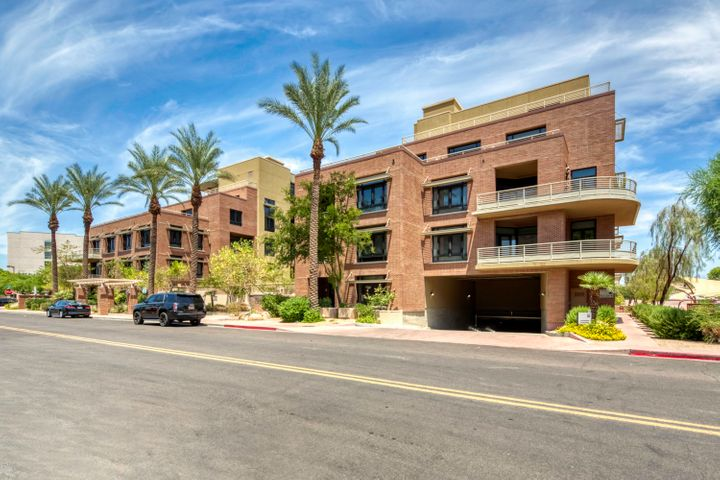 This clean, move-in ready loft offers incredible views of the community pool, Camelback Mountain, and the energy of iconic Scottsdale Rd in the heart of Old Town. Floor-to-ceiling windows usher in plenty of natural light and electric shades block it out when its time to wind down. Granite counter tops, sleek wood cabinetry, exposed ducts, and stainless steel appliances keep the space looking fresh. This versatile loft floor plan can work a few different ways! You can set up the bedroom in the loft area and utilize the first floor as a living space or you can set up your bedroom downstairs and enjoy the loft space as a cozy TV room or office. Luxurious community amenities include concierge, fitness center, pool, spa, outdoor kitchen, 2 underground parking spots, and a storage unit.