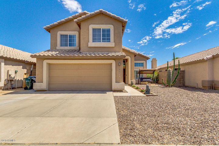 This lovely, well kept, 4 bedroom/ 2.5 bathroom home boasts vaulted ceilings, granite counter tops, spacious master and a  backyard with gorgeous patio and lush turf making it the perfect place to spend time with your family and friends! Near freeways, shopping, entertainment, and great schools. Just a short day trip to many of Arizona's beautiful sights!