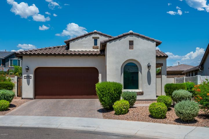 Welcome home to this picture perfect desert retreat, offering modern finishes, open concept living, and easy access to the new Loop 303 freeway. Built in 2017 by Ashton Woods Homes, this stunning property features an open kitchen with soaring ceilings and retractable glass patio doors - perfect for enjoying the indoor/outdoor Arizona lifestyle. The gourmet kitchen is designed with a stunning waterfall center island, bright cabinetry, stainless appliances, and a gas cook top. In addition to a master suite and two guest bedrooms, you'll find a spacious office/den, perfect for working from home. The backyard features low maintenance turf, and a great seating area. Schedule your showing today!