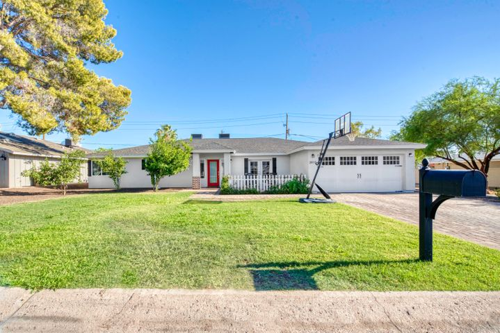 Completely rebuilt in 2014, this charming ranch home is located in one of the most desirable areas in both Phoenix and Arcadia! With close proximity to the canal, Kachina Park, and several local dining hot spots, this location cannot be beat. Inside, you'll find a spacious, open concept with vaulted ceilings, skylights, and polished bamboo floors. The gourmet kitchen features ample cabinet and pantry space, a Carrara marble center island, gas cooktop, and a butcher block breakfast bar. The fantastic split floor plan features a wonderful master retreat with a spa-like ensuite and two closets, three guest bedrooms, and three full bathrooms. Out back, the low maintenance yard is perfect for hosting gatherings and playing in the sun.