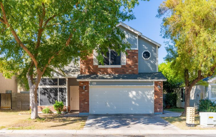 **Multiple Offers Rec'd!** Welcome home to Twelve Oaks: a charming, family-friendly neighborhood nestled among large, mature trees & centered around lush, open-space greenbelts. This 3BR/2.5BA, 1,796 sf two-story home has been lovingly cared for & well-maintained, boasting new carpet, high ceilings, huge bedrooms & two tone paint throughout. Downstairs you're offered two flexible living spaces, a bright + open kitchen w/ pantry, & half-bath for your guests. Upstairs you'll find all three spacious bedrooms, each with great closets & lots of natural light. Backyard has mature shade trees, planting beds, covered patio, storage shed & large, paved seating area. Front lawn + greenbelts maintained by HOA. Walk to school + near all great Chandler shopping, restaurants, amenities +  freeways!
