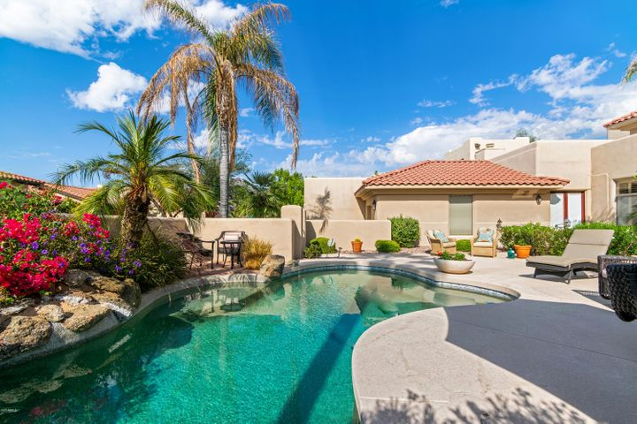 Welcome to this immaculate home located in the highly regarded Biltmore Greens community at the Arizona Biltmore.  Entering the front gate, you are greeted by a private courtyard complete with a sparkling blue pool and stunning patio space.  Inside you will find soaring ceilings and a  functional floor plan with 3 en-suite bedrooms, a den, and an office.  The downstairs master is spacious and offers two walk-in closets!  Other amazing features are the 3 car garage with epoxied floors and tons of storage.  Easy access to hiking trails, shopping, dining, airport, and more!