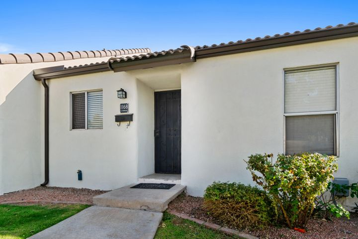 This updated, single-level patio home features vaulted ceilings and wood flooring throughout. The kitchen is designed with stainless steel appliances, granite counters, ample cabinetry, and tile backsplash. With two bedrooms, one full bathroom, a private back patio, and laundry room with storage space, this condo feels like a house! Enjoy the beautiful, quaint community of Torre Blanca, complete with lush landscaping, grassy areas, and a pool.