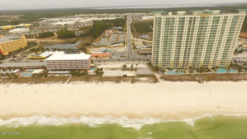 View from South. Aqua on right side. best location on the beach for a new condo or hotel