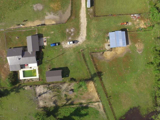 Overhead view of the home, barn and some of the fenced pasture!