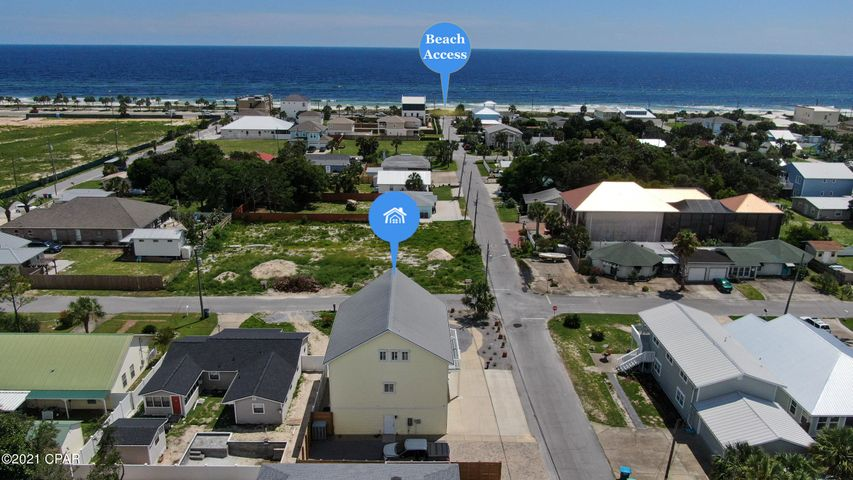 Drone view showing how close the house is to the Bid-A-Wee Beach entrance