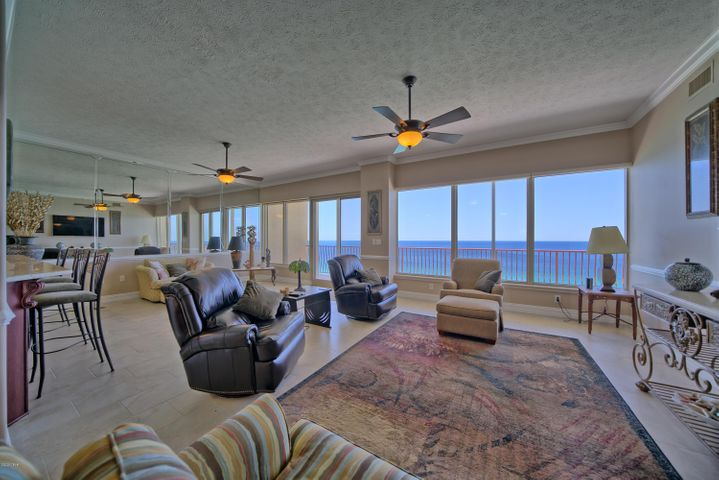 This unit is on the much desired 18th floor which has 10 ft ceilings. The unit has extensive upgrades (over $100,000) during the past year featuring Cherry Wood Cabinets, new tile throughout, new shower doors, new faucets, new trim, completely repainted, new remote control ceiling fans in the living/great room. The unit also has a new GE profile refrigerator, stove top and dishwasher installed in 2019. New Whirlpool washing machine installed during January 2020. HVAC installed in 2015 and includes electronic air filter and UV light system. Remote controlled Hunter Douglas blinds in the living room and Hunter Douglas blackout blinds in the Master bedroom. Equipped with Hurricane Shutters. Covered parking space and storage space and much more. All Information should be verified by the buyer