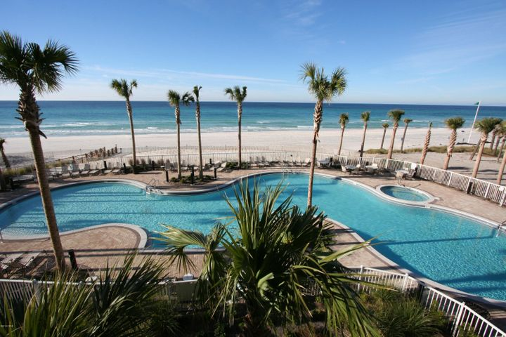 Teeming VR reported $68.1K Gross Rental Income in 2019. This East Corner Penthouse unit has an excellent vista of the Gulf of Mexico & West Bay. Tile flooring decors the common living areas & bathrooms. Hardwood flooring adorns the bedrooms. Large, open chef's kitchen with granite counters, stainless steel appliances & large wet island/breakfast bar. Banquet sized dining room features a wet bar/butler pantry. Large living room & gulf-side balcony. The owner's suite also has it's own private, gulf-side balcony. The owner's en-suite bathroom features a granite double vanity, tiled shower & separate, jetted, garden tub. There is a 3rd private balcony off of the East guest bedroom, which has 270 degrees of, exquisite views. Video conference tour available, ask your agent, or the listing agent.
