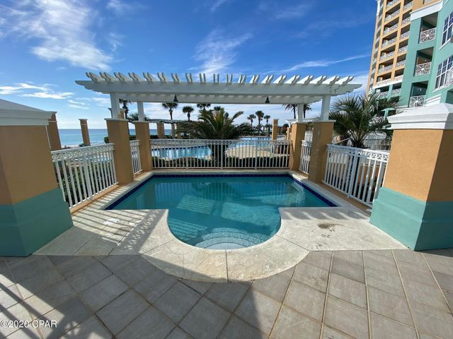 En Soleil is considered by many to be the Premiere Development on Panama City Beach. This Gulf Front Unit sitting on the world's most beautiful beaches you can enjoy the best of luxury living. This beautiful ground floor Penthouse unit has everything you would want in a beach home with 12 ft. ceilings, stainless Steel Appliances, gas fireplace, and summer kitchen with gas grill on a 1700 sq ft patio with its very own 16x10 private plunge pool just a few steps away from the Mater Suite. The complex features a very large lagoon style pool, Gulf Front fitness center, tropical landscaping, hot tubs and 450 feet of beautiful Gulf Front Beach. Just a short drive to Pier Park and the new International Airport. All information is believed to be correct but should be verified by the Buyer.