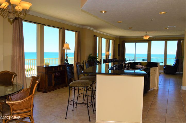 Set your sights on this luxury corner unit in the popular Gulf Crest Condominiums. Tthis 3BR/2BA with a bunk space conveys all the virtues of a coastal storybook, overlooking the sugary sands of the World's Most Beautiful Beaches and the emerald waters of the Gulf of Mexico.  Fully-furnished and rental ready, you will enjoy panoramic views of the water and can access the wrap-a-round balcony from every room!  Features include a split-bedroom floor plan, tile floors, crown molding along the 9' ceilings, granite countertops, and this unit does come with a deeded parking space.  Gulf Crest is a gated community with two gulf-front pools,  whirlpools, pavilions, kiddie pool, fitness center, tiki bar & grill, and a game room.  You're walking distance to several restaurants and family-friendly activities and only a 5-10 minutes drive to St Andrews State Park, shopping centers and more!  All info is approx and must be verified by Buyers if important.