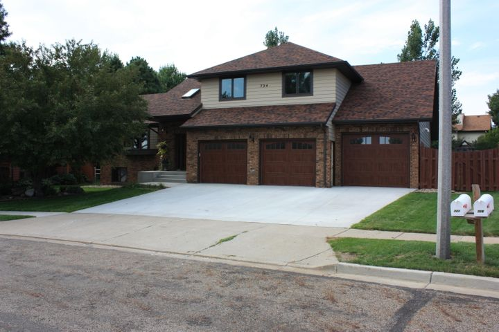 This home is ready for new owners! The large entry with hard wood floors is just beautiful!  There is a formal living room and dining room that could also be used for a kids area or home school room; another family room with a wood burning fireplace and a wet bar!  A large eat in kitchen with a two level deck off the eating area and the family room with a pergola that stays!  The upstairs has a fabulous master suite with a laundry area in the massive master closet!  Double sinks, a jet tub and still a full tub and shower in the master bath complete this must have space!  Two additional large bedrooms and a full bathroom complete the upstairs area.  New paint, carpet (main level and upstairs) and bathroom flooring was just installed after the owners moved out!!  The third level has another family room with two additional bedrooms and a full bathroom.  The fourth level boasts a bonus room that could be used for almost anything you could think of!  There is also a large unfinished storage room on this level.  The Garage is completely finished with new paint on the walls and floor!  Triple across the front and the third stall is a tandem making room for 4 vehicles!  There is a Mr Heater radiant heat unit in the garage.  Right inside the home from the garage is a half bath with another laundry  hook up if you choose to have the laundry located in that area of the home.  The home also has a radon mitigation system already installed.  The yard has a sprinkler system and is completely fenced with beautiful mature trees giving lots of shade and one produces apples! Call your favorite agent to see this fabulous home today!!