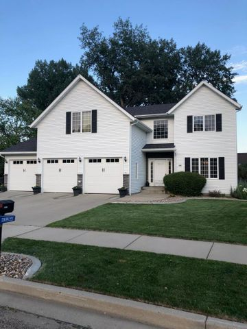 Beautifully updated home in desirable location close to YMCA, Raging Rivers and the Missouri River! Above ground Hotsprings Pool with approx 1,100 Sq Feet of Pool Deck for all your outdoor entertaining!!  4 bedrooms, including the master, on the same floor!! Separate bedroom and bathroom in the basement with a jacuzzi! Over $90,000 of updates to this fantastic home!!  New stainless steel appliances, backsplash, and water osmosis. New ceramic tile in all bathrooms, and laundry room.  Hardwood, laminate and luxury vinyl flooring.  Granit counter tops.  Finished triple garage with gas heater and cabinets including a floor drain and water. Parking pad beside if you have a camper!  There is a park across the street for the kids! Private park-like back yard that is partially fenced if you have pets.  The shed stays!  NO SPECIALS!!!  Call your favorite agent for a private showing today!