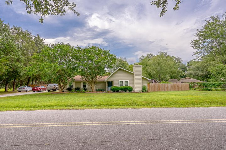 Located on a quiet street just off the main street in Downtown Hardeeville. This spacious three bed, two bath has a formal dining and living room and is perfect for a larger or growing family. The fenced backyard has plenty of room for play with kids or pets and the large addition just off the left can be easily converted to an in-law suite or theater room.  This is a must see located just 20 minutes from Bluffton and Savannah and about 30-minutes from the beaches of Hilton Head.