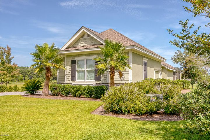 Don't miss the rare opportunity to own a Reardon Brothers custom built home in one of the best resort lifestyle communities in the Lowcountry. This 3 Bed (with 2 Masters) 3 Full Bath Home is situated just behind the 8th tee of the golf course. It features all of the high-end finishes of a Reardon home including Travertine floors, Coffered Ceilings, Granite Countertops, Built-In Bookcases, and Bosch kitchen appliances. The oversized screened lanai is complete with an outdoor kitchen and fountain. As a bonus, the 2.5 car garage is climate controlled for the workshop enthusiast. Amenities include clubhouse, pool, fitness, discounted golf and more.