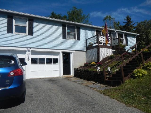 2 car garage w/paved driveway
