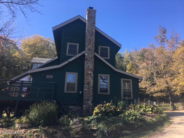 Stunning angles, newly built stone chimney; post & beam home.