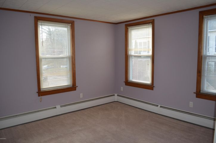 Bedroom with natural wood trim