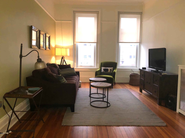 Living Room, beautiful wood floors, large windows, view over Main St