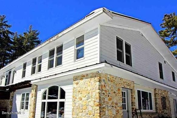 Partial stone construction adds character to this BIG family or vacation home.