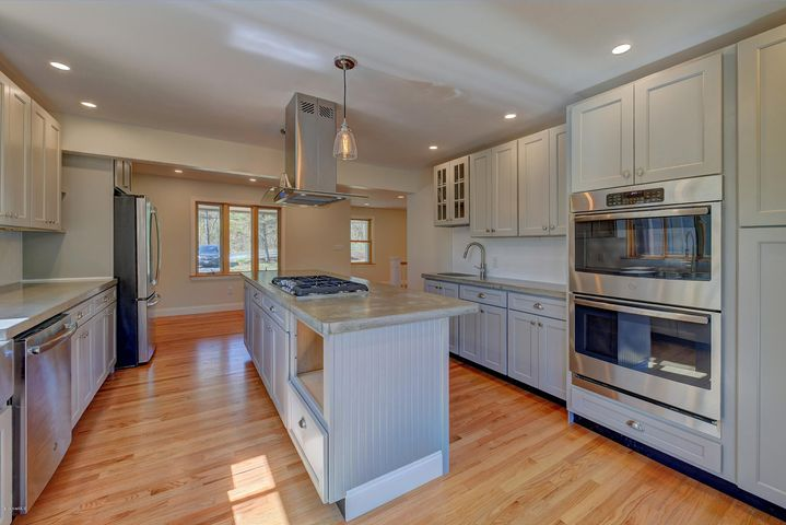 Everything is new. Cement Counter; tops 2 sinks with double ovens, island cook top